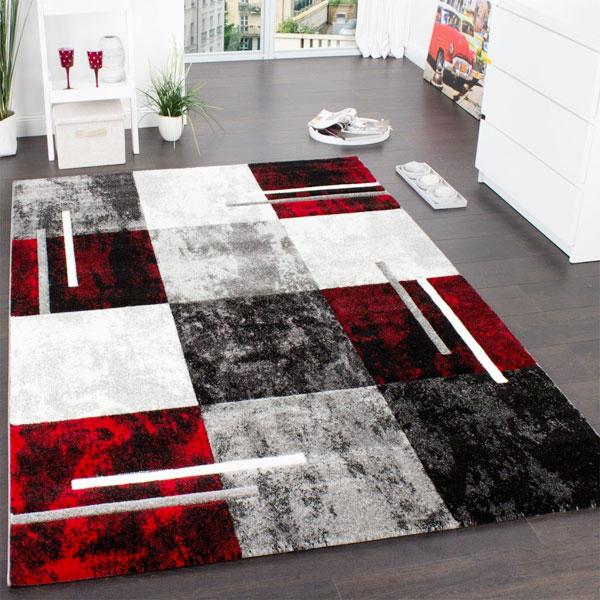 Arredare l'ingresso con tappeto di design marmorizzato rosso